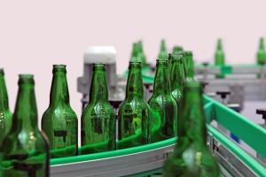 Bottles on conveyor for washing